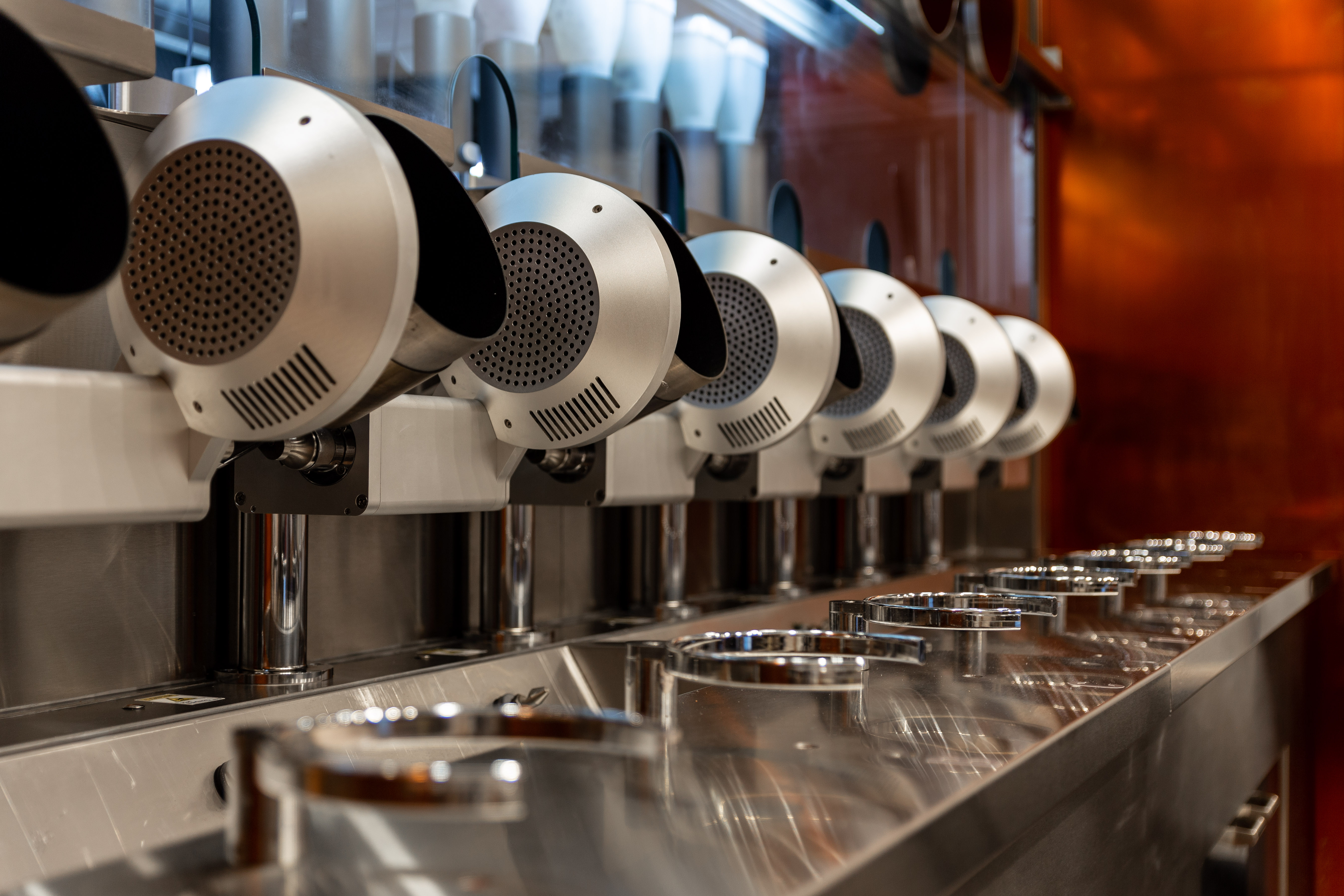 Spyce-Restaurant-Robotic-Kitchen-Boston-Close-up-of-Woks