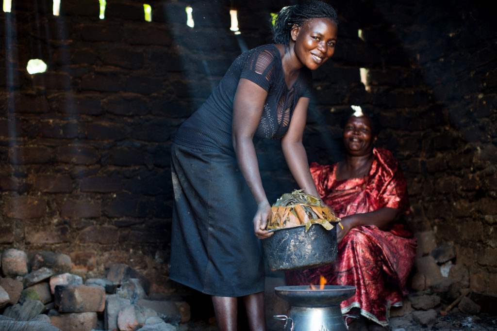 Uganda_Woman-Using-HomeStove_cooking