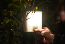 Person using nowlight off-grid light developed by startup Deciwatt.