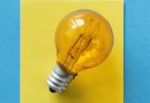 Yellow light bulb on a blue background.