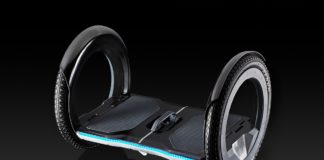 UrmO foldable electric lightweight scooter on a black background.