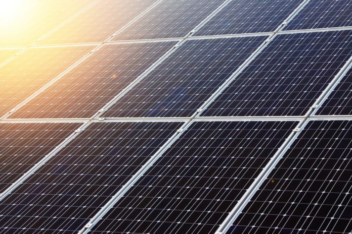 Sun shining on a solar panel.