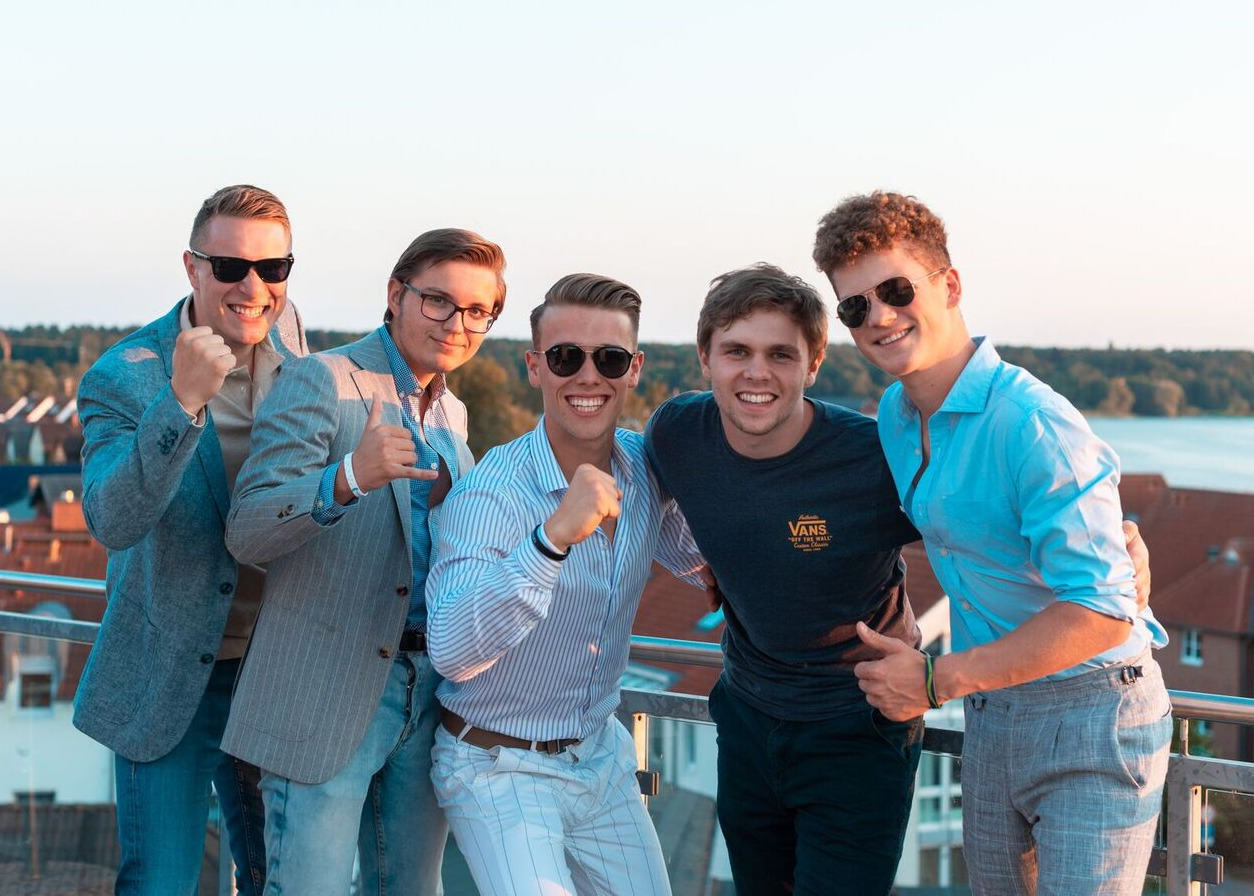Five teenage founders of digital marketing agency White Lion Agency standing in a roof of a building.