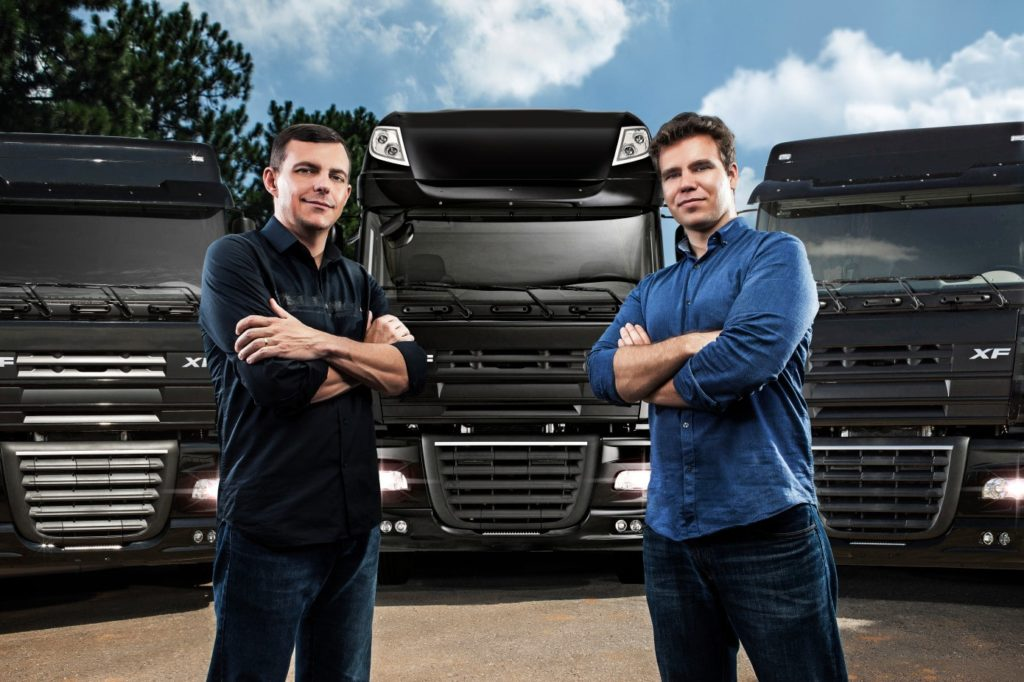 CargoX Founders Standing in Front of Trucks