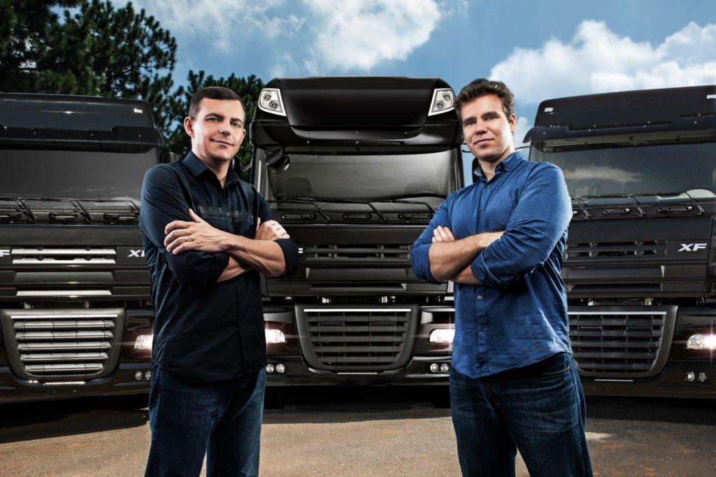 CargoX Founders Standing in Front of Trucks